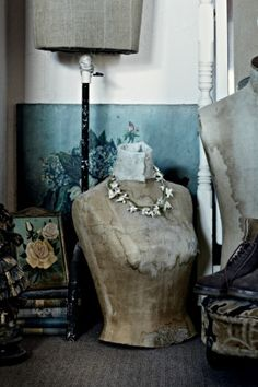 Antique mannequins and faded floral artworks. Photographed by Sharyn Cairns.