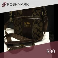 NWOT brown crossbody. Not sure if this bag is authentic. Leaning towards not. But it's a really nice new crossbody for fall. Comes with dust bag. Bags Crossbody Bags