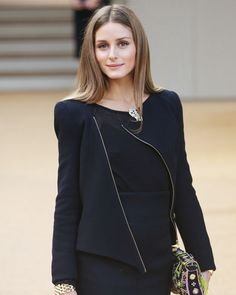 Jet-setter Olivia Palermo crossed the pond to attend the London Fashion Week, wearing a black dress with an asymmetric jacket to the Burberry Prorsum spring/summer 2014 show.
