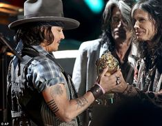 Legendary presentation: Aerosmith's Steven Tyler and Joe Perry presented Depp with the MTV Generation Award which in the past has been given to Adam Sandler, Jim Carey and Sandra Bullock