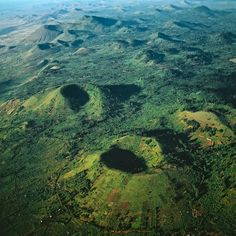 CRATER FIELDS, MARSABIT, KENYA, AFRICA There are more than 200 craters on the flanks of Marsabit, a huge shield volcano which rises about 1,000 metres above the Chalbi desert in Northern Kenya like a green island.