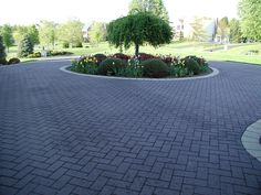 Landscaping and Decorative stamped asphalt driveways go hand in hand.