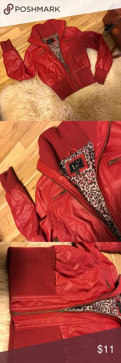 Red leather biker motor jacket Adorable red vegan leather biker jacket with stretch waist. Size large. Cheetah lining so cute! So comfy! Wear this all summer long on cold nights! Flawless except for stain on back of waist band see pics. I haven't tried to get this discoloring out myself so it might just wash out no problem!!! You will love this purchase! Bundle and save!! Xoxo Jackets & Coats