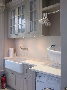Laundry Day - Painted cabinets and fabric  behind glass doors Laundry Room ideas