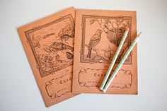 Notebook of the 60s with drawing of animals and a pair of vintage pencils with an engraving of the multiplication table.