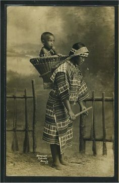 Igorot Woman Carrying Her Child In A Basket, Baguio, Philippine Islands ca. 1900s