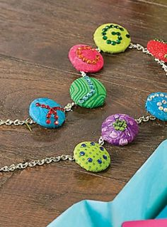 Check out this bright and colorful DIY Buttons and Bling Necklace for back to school. | DIY kids jewelry