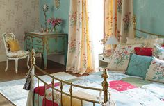 Want a look that's a little more whimsical? Choose a mixture of patterns and colours - choosing shades from a palette of pale and punchy jewel colours. Romaine collection, Harlequin (opens in a new window).
