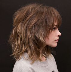 Medium Messy Shag with Arched Bangs Amp up volume of medium shag haircuts with a texturizing spray for a messy vibe. The organized chaos of the cut and arched bangs that make eyes pop will… Curly Hair With Bangs, Hairstyles With Bangs, Straight Hairstyles, Trendy Hairstyles, Layered Hairstyles, Med Shag Hairstyles, Popular Hairstyles, Thick Hair, Summer Hairstyles