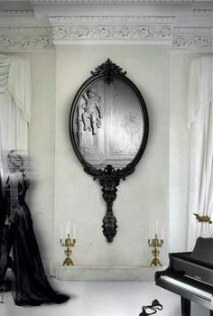 Gothic style mirror. Want one of these. It looks like a giant hand mirror. Love.