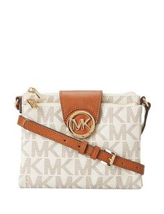 869749e70f85 MICHAEL Michael Kors creates a monogram print crossbody . This bag is  composed of MK print