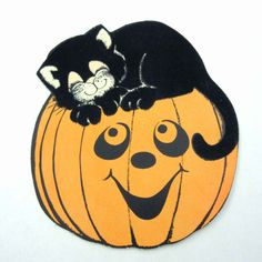Vintage Halloween Die Cut Decoration with Flocked Black Cat Sleeping on Orange Jack O Lantern