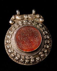 Turkmenistan   Prayer plaque; high grade silver with arabic inscribed carnelian medallion   Mid 20th century   Ersari or Yomut