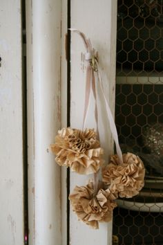 coffee filter pom poms (in a different color) on the back of guests chairs