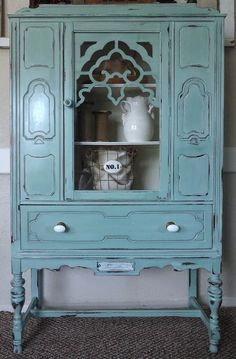 Depression Era Hutch Redo - Inspiration for our hutch makeover. . . . I wonder if Hal would let me do this to the dinning room??? NOT!