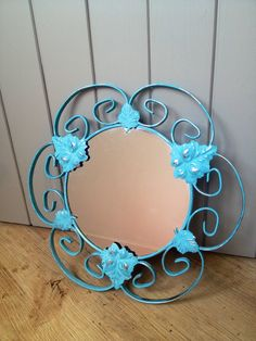 Ornate iron leaf mirror, hand painted with Annie Sloan chalk paint in Provence.