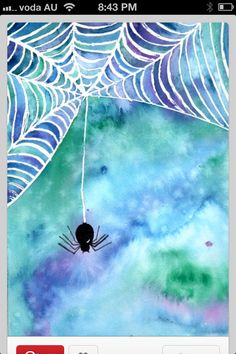 White crayon (or wax pencil) and black spider. Then watercolor background!