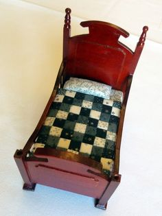 miniature quilt on a miniature bed.  Linens made too.  So cute.  Tons more at the site.