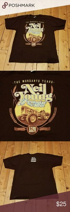 Neil Young the Monsanto years concert t mens XL This t shirt is from Neil Youngs concert in Utah. It's dark brown graphic t shirt mens XL. The pictures show what it says. It's in excellent condition. Please contact me with any questions, also I do bundles if interested, great way to save money! Neil Young  Shirts Tees - Short Sleeve