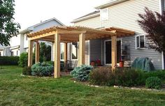 Built over an existing patio space, this multi-level, cedar pergola north of Des Moines in Johnston was custom-designed and built specifically for this space. Archadeck of Central Iowa is your custom pergola builder in Des Moines and Central Iowa areas! Deck Shade, Cedar Pergola, Back Deck, Outdoor Living, Outdoor Decor, House Front, Backyard Patio, Trellis, Outdoor Structures