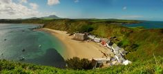 Wales - I love how this village is nestled along the bay...Man in perfect harmony with Nature.