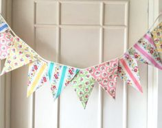 This lovely fabric banners is made of mixed shabby chic style cotton fabric in the cute and sweet patterns. It is perfect for spring and summer!! This fabric banner can be used for room decoration for wedding, new born, boy and girl, furniture decoration such as window, bed, table, for parties such as baby shower, birthday, etc and photo prop.  ~~~~ Size ~~~~  Each flag size is 8.5 (H) x 7 (top width) and double-sided, so you not only can hang them against the wall but also hang in the…