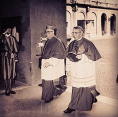 Cardinal Albino Luciani of Venice going into the Papal Enclave after the death of Pope Paul VI to elect the next Pope (with another Cardinal). He couldn't possibly know he would be elected and leave the Enclave as  Pope John Paul I