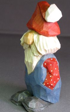 Fudge stands 4 inches tall counting his hat, and is lovingly carved from a single piece of basswood.