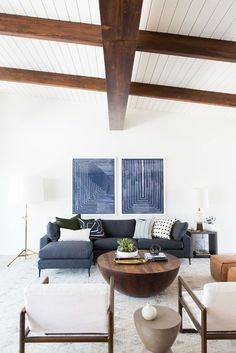 Navy, white and natural color story for a modern living room design | Image via Studio McGee