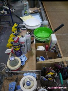 "Screen printing ""tools."" Paints, work orders, sprays all next to the drying machine. Oh, the possibilities."