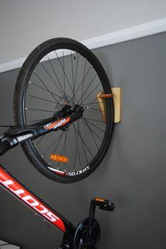 Bike rack - bike storage - bike hanger Save time and space by hanging your bike indoors or outdoors. Rack Velo, Diy Bike Rack, Bike Hanger, Bicycle Storage, Bicycle Rack, Indoor Bike Rack, Bicycle Decor, Old Bicycle, Hanger Rack