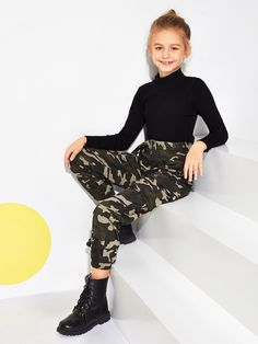 Product name: Girls Flap Pocket Belted Camo Pants at SHEIN, Category: Girls Pants & LeggingsGirls Letter Tape Crisscross Back Tank Jumpsuit SHEIN offers fashionable Girls Pants & Leggings & more to meet your needs. Teenage Girl Outfits, Dresses Kids Girl, Kids Outfits Girls, Cute Girl Outfits, Cute Outfits For Kids, Cute Casual Outfits, Girls Pants, Cute Clothes For Kids, Trousers For Girls