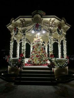 Beautiful Christmas tree and lights decorated outdoors in the gazebo. Christmas Scenes, Noel Christmas, Victorian Christmas, Winter Christmas, Christmas Lights, Xmas, Christmas Wedding, Holiday Ornaments, Beautiful Christmas Trees