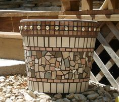 Oooh... adhere tile, marbles, decorations to terra cotta pots, then grout.