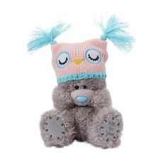 Tatty Teddy with an adorable owl hat. Perfect for a winter cuddle!
