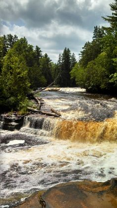 Tahquamenon Falls, in Michigan's upper peninsula. A beautiful place to vacation in the summer;)