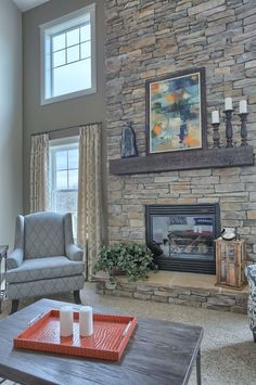 The Chic Technique: Beautiful stone surround fireplace. Home Fireplace, Fireplace Remodel, Living Room With Fireplace, Fireplace Surrounds, Fireplace Design, Home Living Room, Stone Fireplaces, Fireplace Refacing, Stone Fireplace Decor
