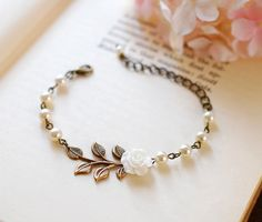Bronze aged wire with leaves, white rose and pearl bracelet. So pretty for bridesmaids!