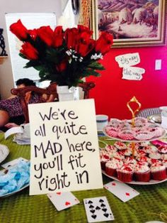 """We're all quite MAD here you'll fit right in"" sign, dessert, playing card cupcakes, Very Merry Un-Baby Shower mad hatter tea party inspired baby shower theme alice in wonderland decor According2shirley.blogspot.com"
