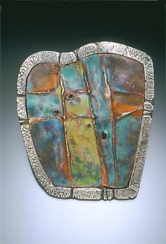 """Orange & Blue Carapace  Materials: Enamel, copper, silver metal clay Dimensions: 7 1/2"""" X 6 1/2"""" X 1/2""""  Pendant; Torch-fired enamel on fold-formed copper; silver metal clay and sterling fabricated setting  Photo credit: Ralph Gabriner  Leni Fuhrman New York, NY. USA"""