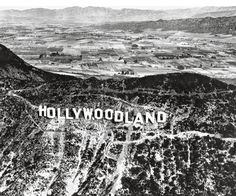"The sign was first erected in 1923 and originally read ""HOLLYWOODLAND""."