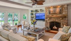 Maine-Inspired Shingle Coastal Cottage-offset fp with rustic mantel and white builtins