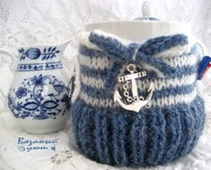 #mugcozy , #cupcozy , #knitgift , 10 $ This adorable knit mug cozy will keep your hands cool while sipping your favorite hot drink. The cozy has a decorative buttons, hat with flowers, a bag from Chanel, Boucicaut and bow.  It will fit most large coffee mugs and to go cups from your favorite coffee shop.  Mug not included. Will keep your drink warm or cold. It does have a little bit of stretch to it so it will fit a wide variety of cups.