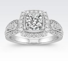Crafted from superior quality platinum, this distinctive vintage inspired halo design features 66 brilliant round diamonds, at approximately .50 carat total weight.  This ring is made to hold a center stone at approximately 1.00 carat.