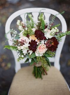 Love this loose, hand-tied bouquet with fern, veronica, chrysanthemums and garden roses. Gorgeous!