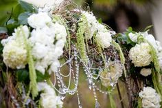 Wedding arch.  love the mix of crystals and organic material.  nice change.