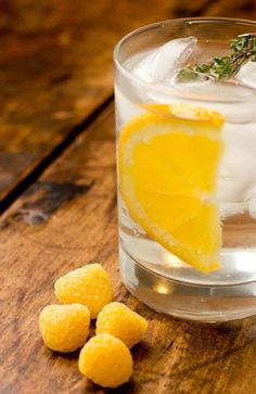 Vodka tonic with lemon and yellow raspberries! Oh, I saw these yellow friends yesterday at the farmers market and they tasted soooo good.