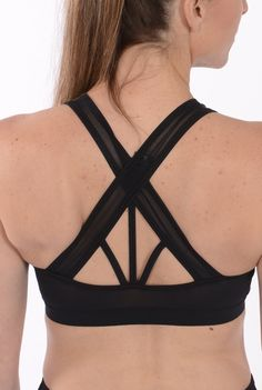 Looking for a cute, strappy bra that is supportive too? Our Loko Sport Strappy Back Bra features wide cross straps to keep you supported. The entire back is made from Power Net Mesh. Power Net was originally used in girdles. Today you can find it on the sides and backs of many of your bras. We get ours from a lingerie supplier in Montreal. Our removable bra cups for this bra are also manufactured for us in Montreal. Layer this bra under our Loose Fit Mesh Tank for a cool, comfortable look.