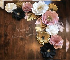Rose gold, gold, black and white paper flowers with tropical leafs