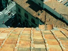 The roofs of Umbria are sources of endless fascination.  The age of the clay tiles, and the varying times for their replacement, creates a wide variety of color and texture.  These roofs are perfect objects for photographs.